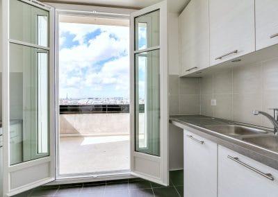 renovation appartement locatif ledru rollin paris cuisine avec vue evier kaizo studio architecte interieur paris bourg la reine web