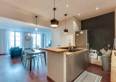 transformation atelier en appartement aboukir paris cuisine inox salle a manger sejour kaizo studio architecte interieur paris bourg la reine web