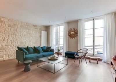 transformation atelier en appartement aboukir paris sejour mur en pierre kaizo studio architecte interieur paris bourg la reine web