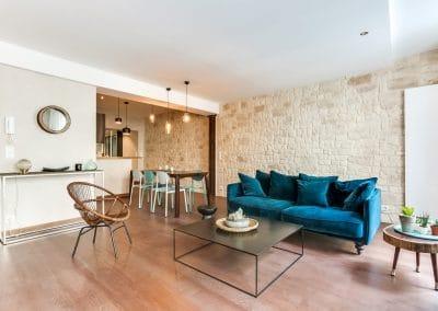 transformation atelier en appartement aboukir paris sejour mur en pierre salle a manger cuisine kaizo studio architecte interieur paris bourg la reine web